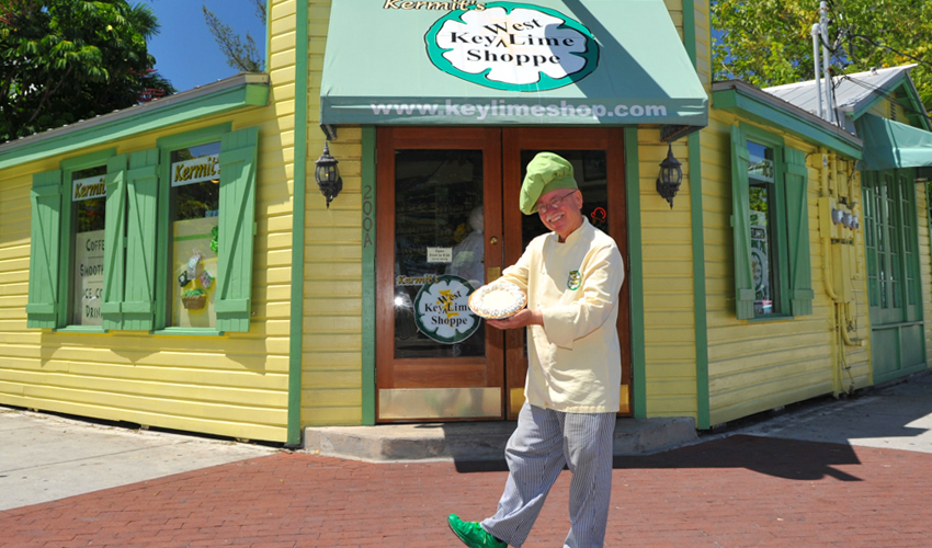 Man holding pie in front of Kermits Key West Key Lime Shoppe