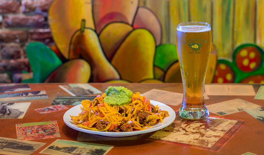 loaded nachos with beer at el meson de pepe